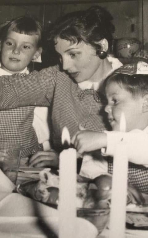 Ruth lighting Sabbath candles with Camilla's stepmother Bernice Tominey (left) and Bernice's brother Martin (right) - Credit: TMG