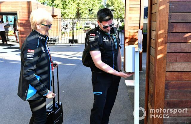 """Williams Team Members use hand sanitizer before entering the track <span class=""""copyright"""">Mark Sutton / Motorsport Images</span>"""