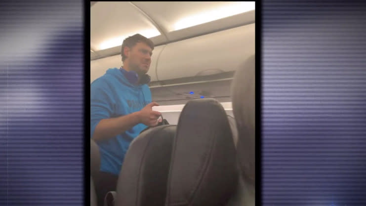 James Clayton Cholewinski-Boyd, 32, pictured being forced to get off the flight.