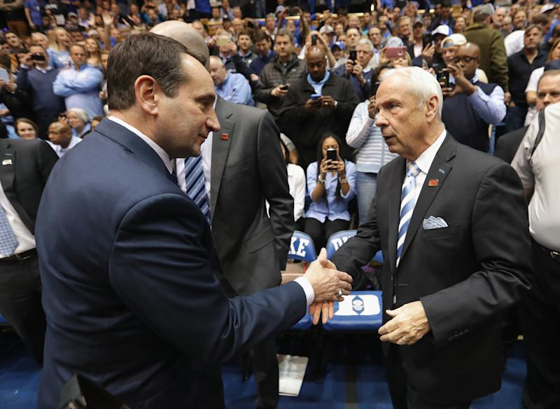 Mike Krzyzewski of the Duke Blue Devils and head coach Roy Williams of the North Carolina Tar Heels shake hands prior to a game. (Streeter Lecka/Getty Images)