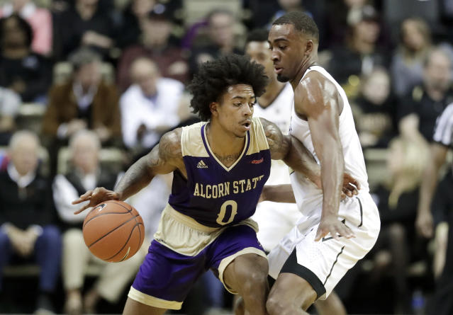 Alcorn State guard Troymain Crosby (0) drives against Vanderbilt guard Joe Toye in the first half of an NCAA college basketball game Friday, Nov. 16, 2018, in Nashville, Tenn. (AP Photo/Mark Humphrey)
