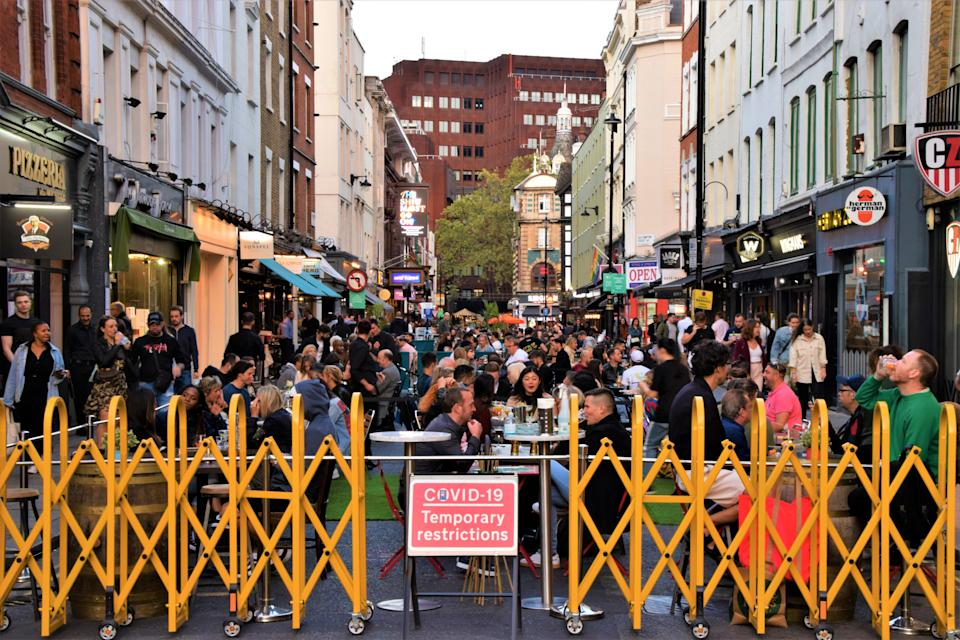 Temporary outdoor bar and restaurant crowded with people in Soho. Sections of Soho have been blocked for traffic to allow temporary outdoor street seating for bars and restaurants during the Covid-19 pandemic. (Photo by Vuk Valcic / SOPA Images/Sipa USA)