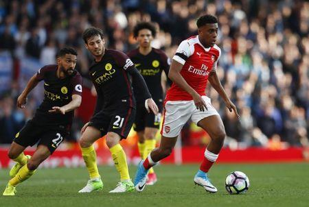 Britain Football Soccer - Arsenal v Manchester City - Premier League - Emirates Stadium - 2/4/17 Manchester City's David Silva in action with Arsenal's Alex Iwobi Reuters / Eddie Keogh Livepic
