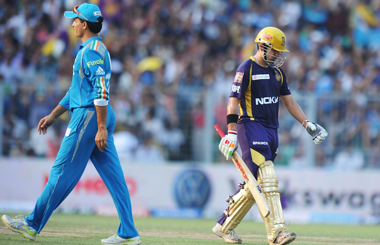 Kolkata Knight Riders batsman Gautam Gambhir (R) walks back as Pune Warriors India captain Sourav Ganguly looks on during the IPL Twenty20 cricket match between Kolkata Knight Riders and Pune Warriors India  at The Eden Gardens in Kolkata on May 5, 2012.  RESTRICTED TO EDITORIAL USE. MOBILE USE WITHIN NEWS PACKAGE.  AFP PHOTO/Dibyangshu SARKAR        (Photo credit should read DIBYANGSHU SARKAR/AFP/GettyImages)