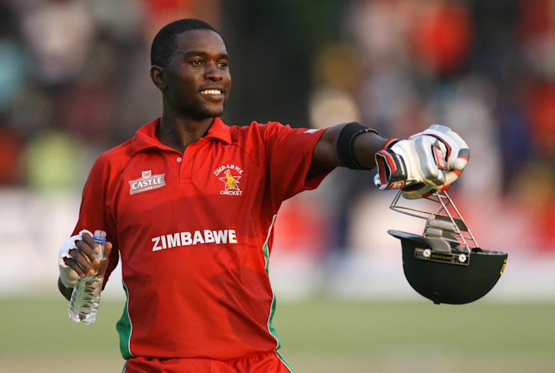 Zimbabwe captain Elton Chigumbura celebrates their victory after the match between Zimbabwe and Australia in the one day international tri-series at the Harare Sports Club on August 31, 2014 (AFP Photo/Jekesai Njikizana )