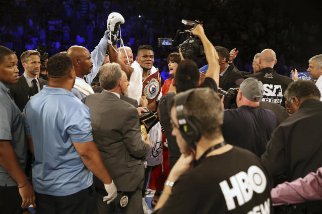Eleider lvarez, center rear, of Colombia, celebrates after he knocked out Sergey Kovalev, of Russia, in the seventh round of their boxing bout at 175 pounds, Saturday, Aug. 4, 2018, in Atlantic City, N.J. (AP Photo/Mel Evans)