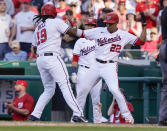 Washington Nationals' Josh Bell (19) celebrates a two-run home run with Juan Soto (22) during the seventh inning of a baseball game against the Pittsburgh Pirates, Wednesday, June 16, 2021, in Washington. Washington won 3-1. (AP Photo/Carolyn Kaster)