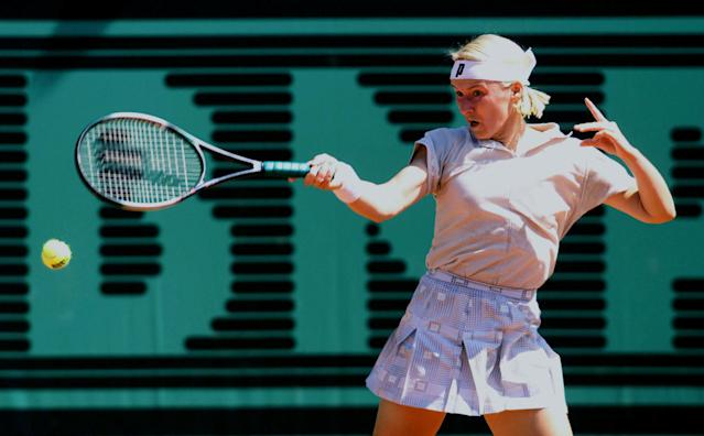 FILE PHOTO: Jana Novotna of the Czech Republic returns a forehand to compatriot Adriana Gersi during their match on the second day of the Roland Garros French tennis open May 26. Novotna defeated Gersi 6-3 6-2. REUTERS/Jacky Naegelen/File Photo