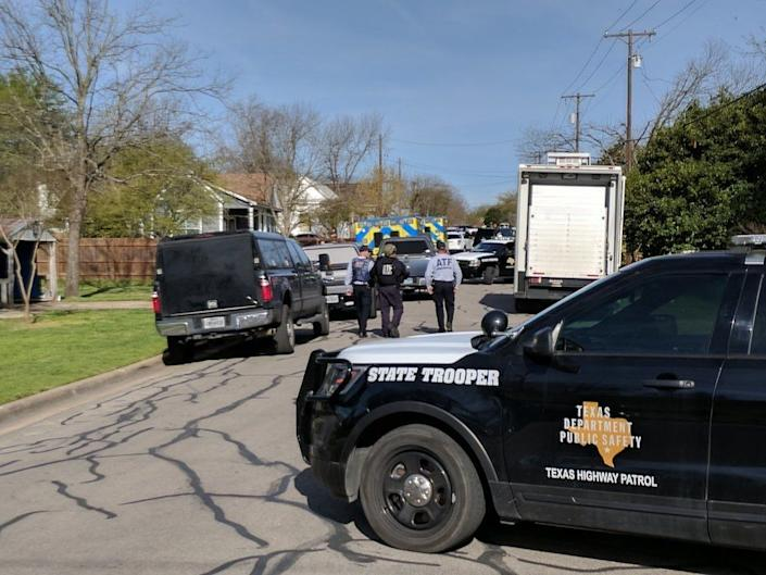 Law enforcement officers are seen blocking a street leading to the home of Mark Conditt. (Photo: Roque Planas/HuffPost)