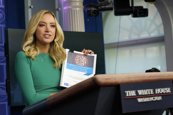 White House press secretary Kayleigh McEnany holds a coronavirus playbook speaks during a briefing at the White House in Washington, Friday, Nov. 20, 2020. McEnany suggested that the team for President-elect Joe Biden can use the coronavirus playbook. (AP Photo/Susan Walsh)