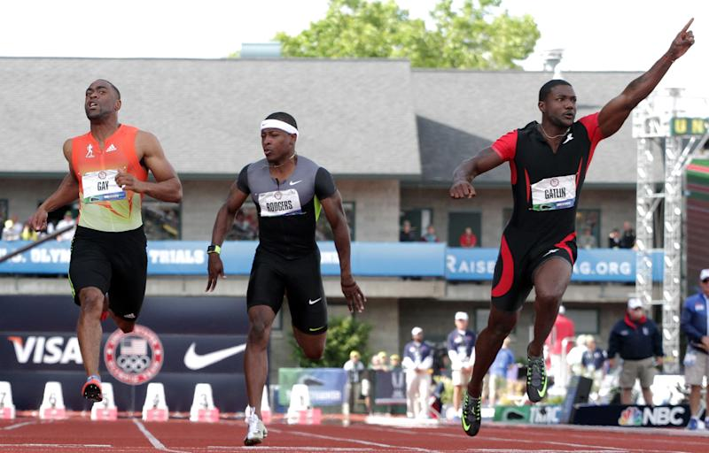 Justin Gatlin, Tyson Gay and Michael Rodgers react after the men's 100m finals at the U.S. Olympic Track and Field Trials Sunday, June 24, 2012, in Eugene, Ore. (AP Photo/Eric Gay)