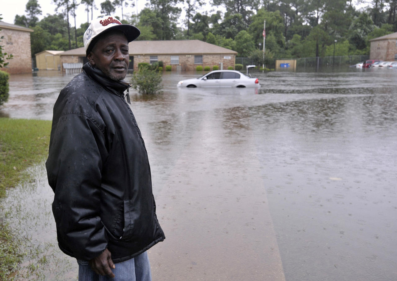 Forest Creek apartment resident Calvin Grace returns from checking on the flooding conditions in his unit Sunday, June 10, 2012, after receiving nearly two feet of water on Saturday, in Pensacola, Fla. Floodwaters from torrential rains damaged homes and closed roads throughout the Florida Panhandle, cutting power to the county jail and sending residents to emergency shelters as the area braced for additional rains Sunday. (AP Photo/The Pensacola News Journal, Tony Giberson) NO SALES; MANDATORY CREDIT: TONY GIBERSON/PENSACOLA NEWS JOURNAL AND PNJ.COM