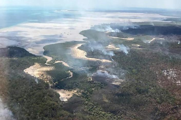 Queensland Parks and Wildlife Service said the fire was burning on two fronts