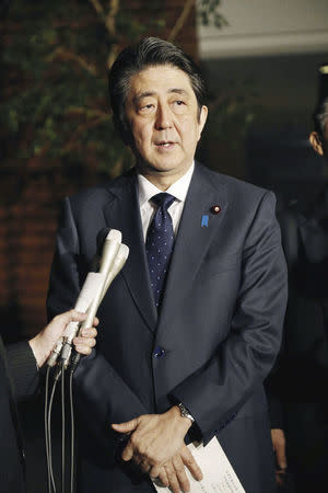"Japanese Prime Minister Shinzo Abe speaks to reporters after South Korea and Japan reached an agreement on ""comfort women"" issue at the prime minister's office in Tokyo, Japan, December 28, 2015. Mandatory credit REUTERS/Kyodo"