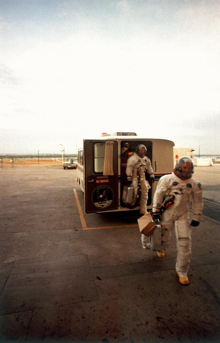 The Apollo 11 astronauts exit the transfer van after they arrive at the mission launch tower in Cape Canaveral, Fla., July 16, 1969. (Photo: Ralph Morse/The LIFE Picture Collection via Getty Images/Getty Images)