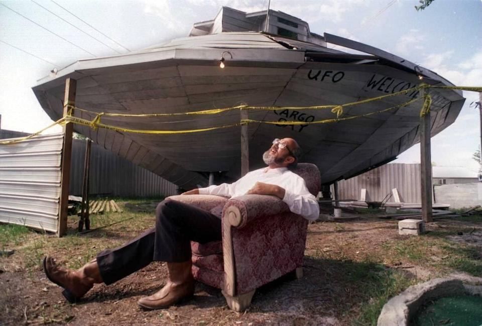 Jody Pendarvis is pictured with his UFO Welcome Center in 1997.