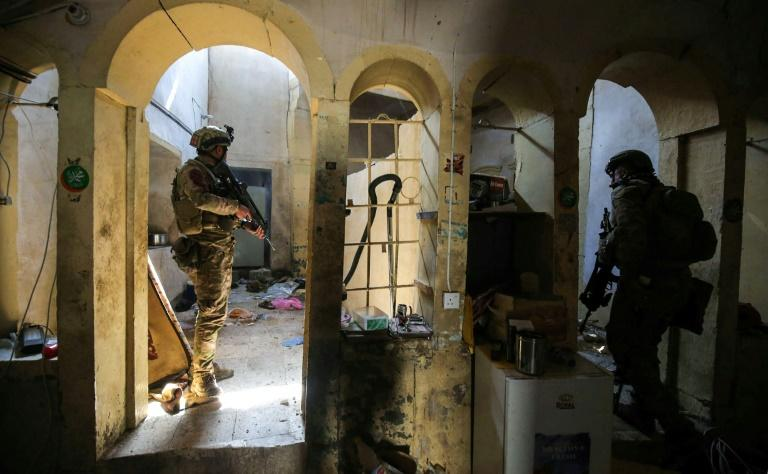 Iraqi forces advance in a house in the Old City of western Mosul as they press an offensive to retake the city from Islamic State group fighters