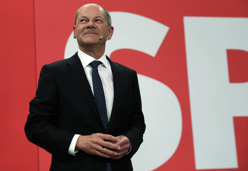 Olaf Scholz, top candidate for chancellor of the Social Democratic Party (SPD) addresses his supporters after German parliament election at the party's headquarters in Berlin, Sunday, Sept. 26, 2021. (AP Photo/Lisa Leutner)