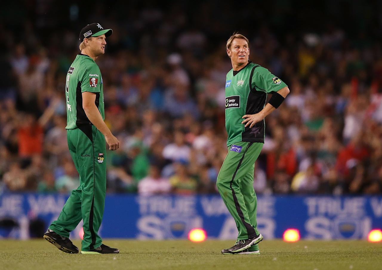 MELBOURNE, AUSTRALIA - DECEMBER 07:  Cameron White with Shane Warne of The Stars who reacts after being hit for six by Ben Rohrer of The Renegades during the Big Bash League match between the Melbourne Renegades and the Melbourne Stars at Etihad Stadium on December 7, 2012 in Melbourne, Australia.  (Photo by Michael Dodge/Getty Images)
