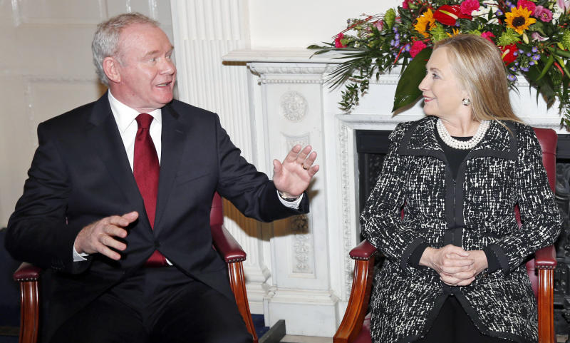 U.S. Secretary of State Hillary Rodham Clinton,  meets with Northern Ireland's  Deputy First Minister Martin McGuinness, left, at Stormont Castle in Belfast, Northern Ireland, Friday,  Dec. 7, 2012. Clinton travelled to Northern Ireland on Friday to lend her support to the British province's fragile peace, the frailty of which was underlined by overnight rioting on the eve of her visit and the seizure of a bomb. (AP Photo, Kevin Lamarque, Pool)