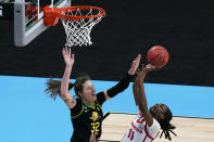 Oregon forward Sedona Prince (32) tries to block a shot by Georgia guard Maya Caldwell (11) during the second half of a college basketball game in the second round of the women's NCAA tournament at the Alamodome in San Antonio, Wednesday, March 24, 2021. Oregon won 57-50. (AP Photo/Eric Gay)