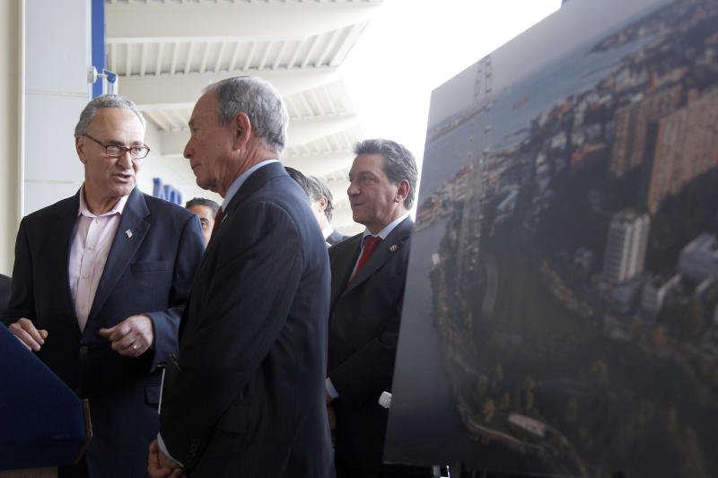 "Sen. Charles Schumer, D-N.Y., and New York City Mayor Michael Bloomberg stand next to an artist rendering of a proposed Ferris wheel during a news conference on the Staten Island borough of New York, Thursday, Sept. 27, 2012. The proposed 625-foot Ferris wheel, billed as the world's largest, planned as part of a retail and hotel complex along the Staten Island waterfront in New York. The attraction, called the New York Wheel, will cost $230 million. Officials say the observation wheel will be higher than the Singapore Flyer, the London Eye, and a ""High Roller"" wheel planned in Las Vegas. Beyond the wheel is the Manhattan skyline.(AP Photo/Mary Altaffer)"