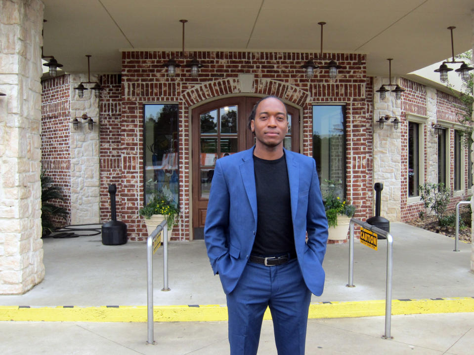 In this Friday, April 12, 2019, photo Jasper city council member Rashad Lewis stands in front of a restaurant in Jasper, Texas, after discussing the legacy of James Byrd Jr.'s death and its impact on Jasper. Byrd was killed on June 7, 1998, after he was chained to the back of a pickup truck and dragged for nearly three miles along a secluded road in the piney woods outside Jasper. John William King, the convicted ringleader of Byrd's death, is set to be executed on Wednesday, April. 24, 2019. (AP Photo/Juan Lozano)