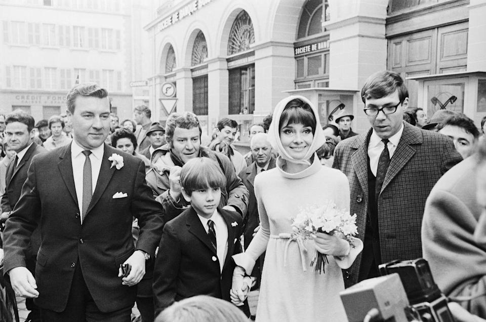 <p>Audrey keeps her son, Sean Ferrer, close at her wedding to Italian psychiatrist Andrea Dotti in 1969. The actress was married to actor Mel Ferrer when she welcomed their son in 1960. </p>