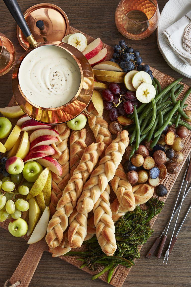 """<p>If your family is more of the grazing type, go all out with a three-cheese fondue board. </p><p><strong><a href=""""https://www.countryliving.com/food-drinks/a28068814/three-cheese-fondue-recipe/"""" rel=""""nofollow noopener"""" target=""""_blank"""" data-ylk=""""slk:Get the recipe"""" class=""""link rapid-noclick-resp"""">Get the recipe</a>.</strong> </p>"""