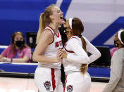 North Carolina State's Elissa Cunane, left, celebrates with Jakia Brown-Turner (11) after North Carolina State's victory over Virginia Tech in an NCAA college basketball game in the quarterfinals of the Atlantic Coast Conference women's tournament Friday, March 5, 2021, in Greensboro, N.C. (Ethan Hyman/The News & Observer via AP)