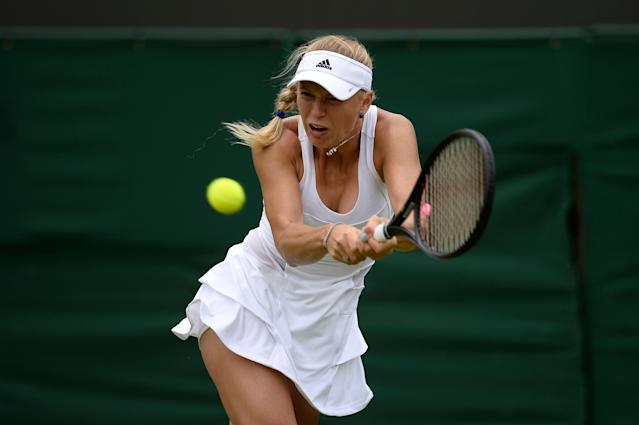 LONDON, ENGLAND - JUNE 26: Caroline Wozniacki of Denmark plays a backhand during her Ladies' Singles second round match against Petra Cetkovska of Czech Republic on day three of the Wimbledon Lawn Tennis Championships at the All England Lawn Tennis and Croquet Club on June 26, 2013 in London, England. (Photo by Dennis Grombkowski/Getty Images)