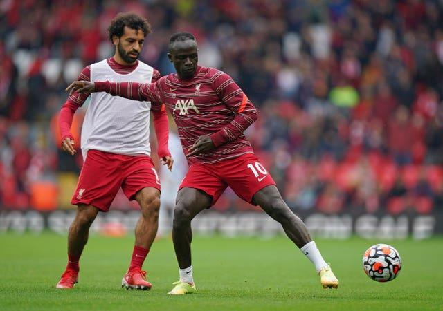 Mohamed Salah and Sadio during a pre-match warm-up