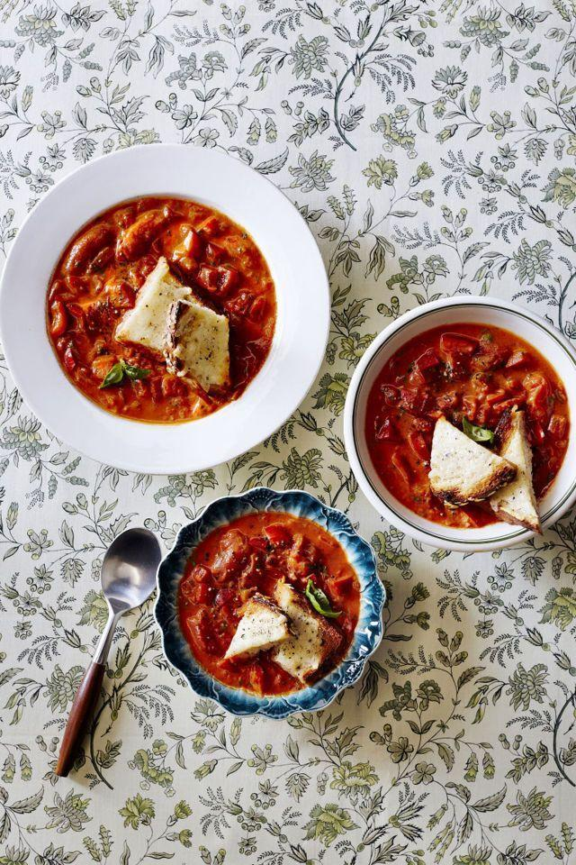 "<p>Feed a crowd with this bright, slightly piquant tomato and pepper soup.</p><p><strong><a href=""https://www.countryliving.com/food-drinks/recipes/a5798/chunky-tomato-red-pepper-soup-recipe-cxl1014/"" rel=""nofollow noopener"" target=""_blank"" data-ylk=""slk:Get the recipe"" class=""link rapid-noclick-resp"">Get the recipe</a>.</strong></p><p><a class=""link rapid-noclick-resp"" href=""https://www.amazon.com/Cook-Home-02418-Stainless-Stockpot/dp/B00Z4TSE32/?tag=syn-yahoo-20&ascsubtag=%5Bartid%7C10050.g.3569%5Bsrc%7Cyahoo-us"" rel=""nofollow noopener"" target=""_blank"" data-ylk=""slk:SHOP SOUP POTS"">SHOP SOUP POTS</a></p>"