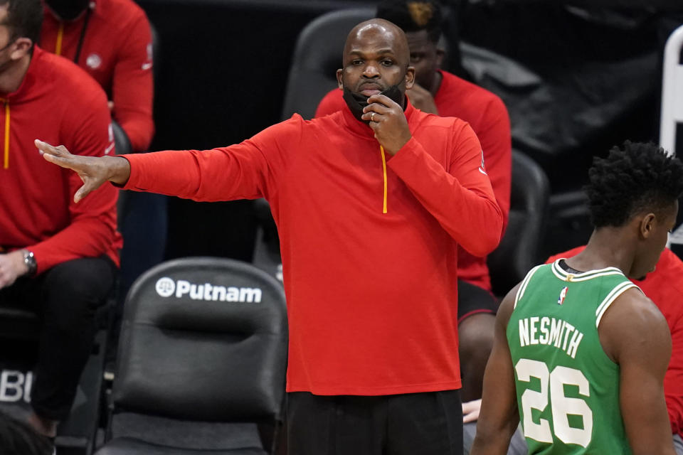 FILE - Atlanta Hawks associate head coach Nate McMillan calls to his players during the second half of an NBA basketball game against the Boston Celtics in Boston, in this Wednesday, Feb. 17, 2021, file photo. Newly named Atlanta Hawks interim coach Nate McMillan will have his debut in Tuesday night's, March 2, 2021, game at Miami. His opportunity to return to a head coach position comes with mixed feelings following Monday's firing of his friend, Lloyd Pierce. (AP Photo/Charles Krupa, File)