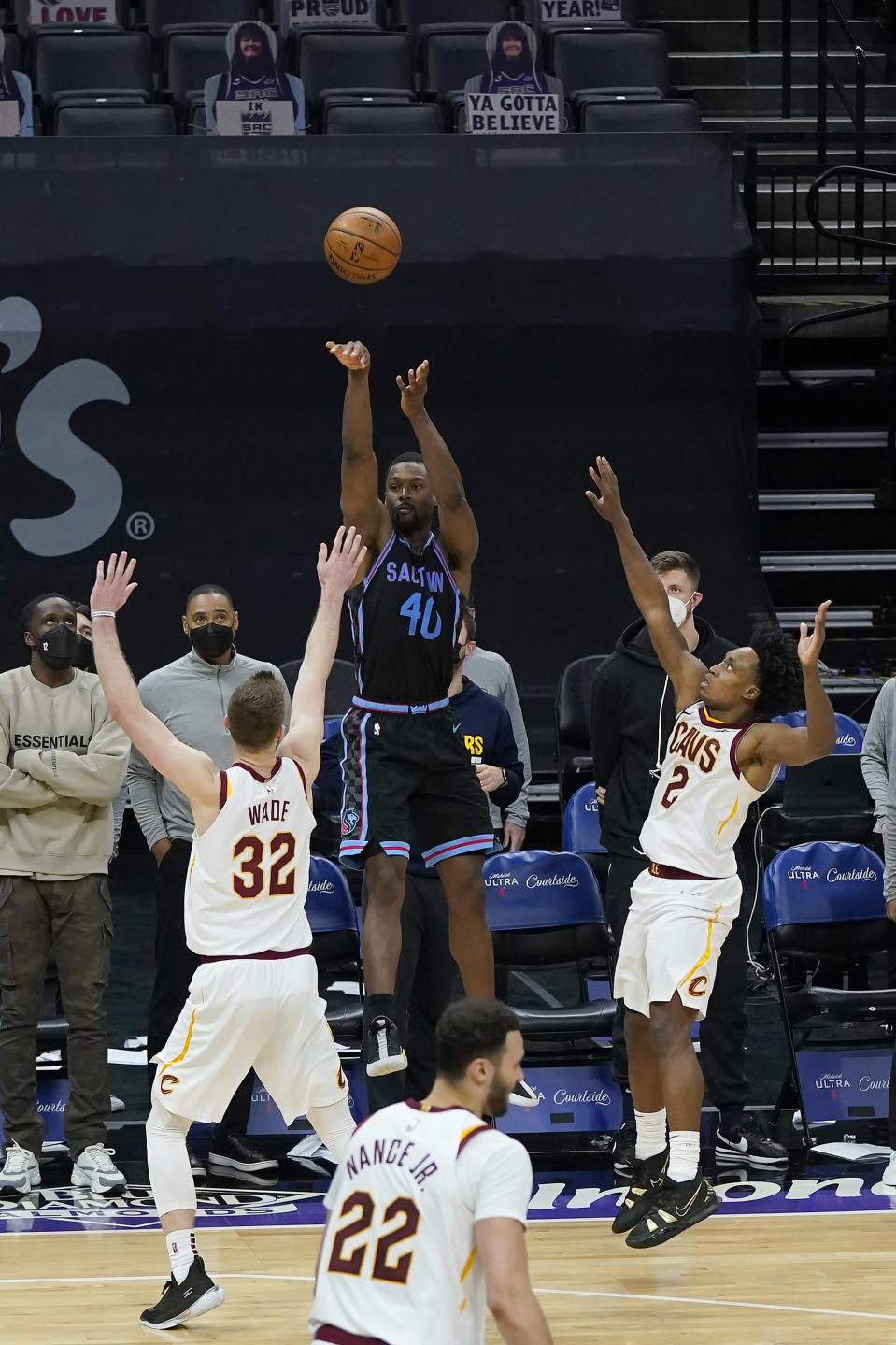 Sacramento Kings forward Harrison Barnes (40) shoots a 3-point basket next to Cleveland Cavaliers forward Dean Wade (32) and guard Collin Sexton (2) during the second half of an NBA basketball game in Sacramento, Calif., Saturday, March 27, 2021. (AP Photo/Jeff Chiu)
