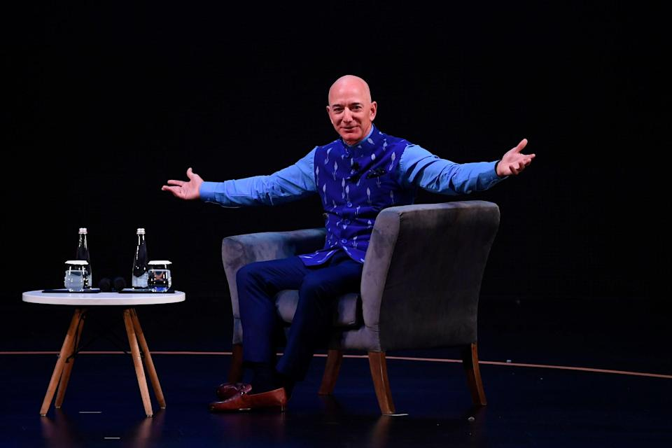 <p>File Image: CEO of Amazon Jeff Bezos (R) gestures during the Amazon's annual Smbhav event in New Delhi on 15 January 2020</p> (AFP via Getty Images)