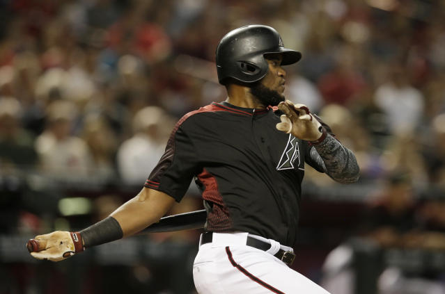 Arizona Diamondbacks' Socrates Brito hits into a fielder's choice RBI in the second inning during a baseball game against the Cincinnati Reds, Monday, May 28, 2018, in Phoenix. (AP Photo/Rick Scuteri)