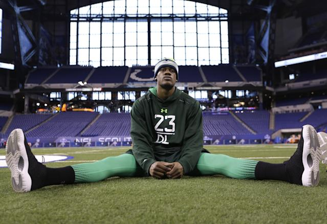 Nebraska defensive lineman Randy Gregory stretches before drills at the NFL football scouting combine in Indianapolis, Sunday, Feb. 22, 2015. (AP Photo/David J. Phillip)