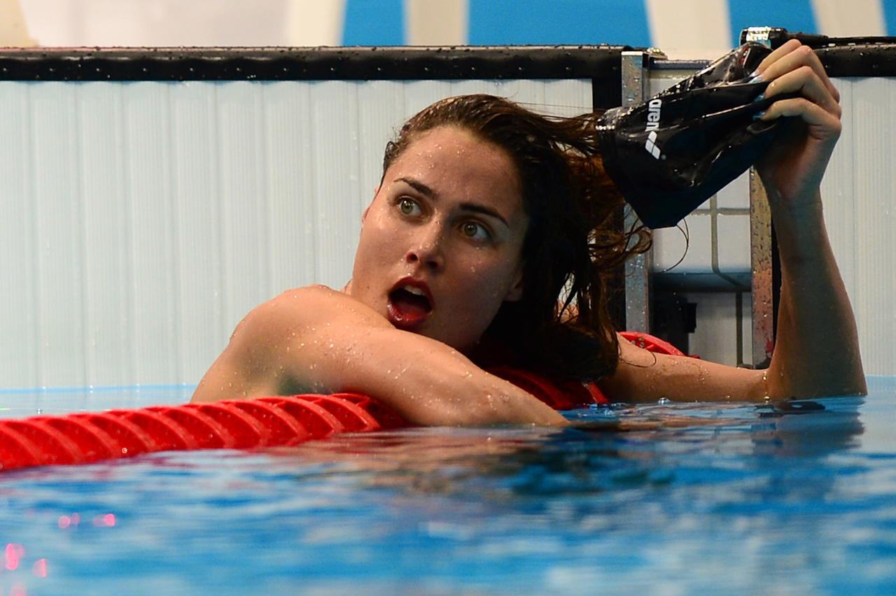 Hungary's Zsuzsanna Jakabos reacts after she competed in the women's 200m butterfly heats during the swimming event at the London 2012 Olympic Games on July 31, 2012 in London.  AFP PHOTO / MARTIN BUREAUMARTIN BUREAU/AFP/GettyImages