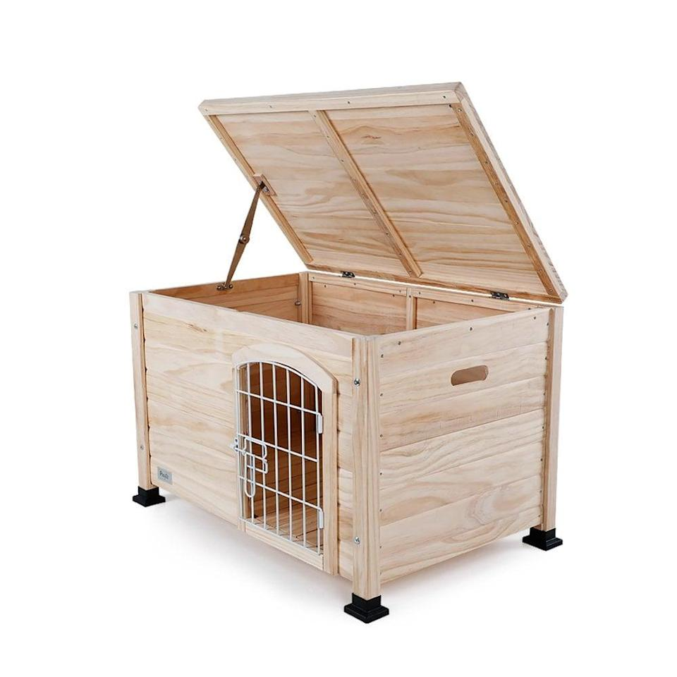 """<p>This simple <a href=""""https://www.popsugar.com/buy/Petsfit%20Indoor%20Wooden%20Pet%20House%20With%20Wire%20Door-434002?p_name=Petsfit%20Indoor%20Wooden%20Pet%20House%20With%20Wire%20Door&retailer=amazon.com&price=110&evar1=moms%3Aus&evar9=46016697&evar98=https%3A%2F%2Fwww.popsugar.com%2Ffamily%2Fphoto-gallery%2F46016697%2Fimage%2F46016727%2FPetsfit-Indoor-Wooden-Pet-House-Wire-Door&list1=dogs&prop13=api&pdata=1"""" rel=""""nofollow noopener"""" target=""""_blank"""" data-ylk=""""slk:Petsfit Indoor Wooden Pet House With Wire Door"""" class=""""link rapid-noclick-resp"""">Petsfit Indoor Wooden Pet House With Wire Door</a> ($110) is an indoor pet crate that can be painted so it matches your living room furniture and offers access to your pet through a gate and a lid.</p>"""