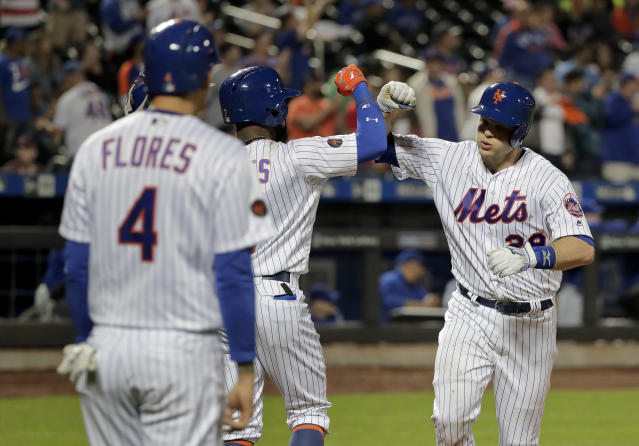 New York Mets catcher Devin Mesoraco (29) celebrates with teammates after hitting a three-run home run against the Toronto Blue Jays during the eighth inning of a baseball game Tuesday, May 15, 2018, in New York. The Mets won 12-2. (AP Photo/Julie Jacobson)