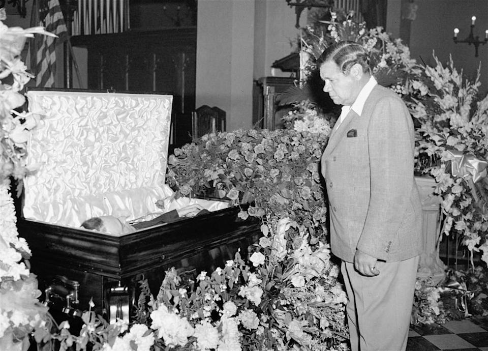 Babe Ruth pauses beside the body of one time New York Yankee teammate, Lou Gehrig, at Christ Episcopal Church in the Bronx, New York, June 3, 1941.