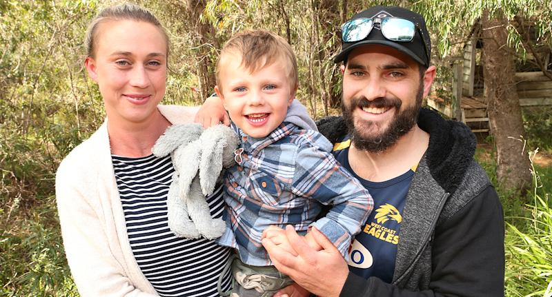James is pictured with his mum and dad after being found alive and well in dense bushland. Source: Jackson Flindell