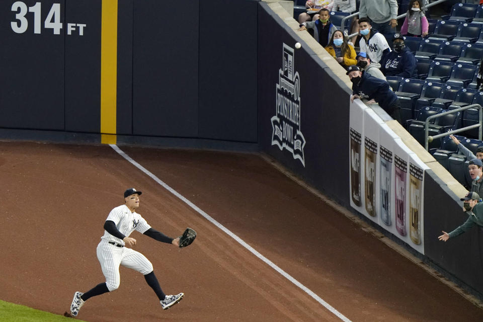 New York Yankees right fielder Aaron Judge fields chases after Baltimore Orioles Trey Mancini's third-inning ground rule double in a baseball game, Tuesday, April 6, 2021, at Yankee Stadium in New York. (AP Photo/Kathy Willens)