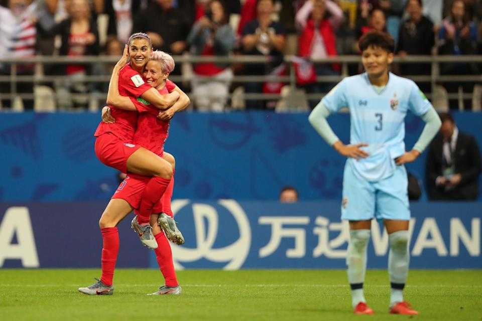 REIMS, FRANCE - JUNE 11: Alex Morgan of USA celebrates with Megan Rapinoe of USA  after scoring a goal to make it 12-0 during the 2019 FIFA Women's World Cup France group F match between USA and Thailand at Stade Auguste Delaune on June 11, 2019 in Reims, France. (Photo by Molly Darlington - AMA/Getty Images)