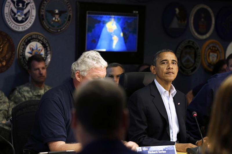 President Barack Obama pauses before speaking to the media at the National Response Coordination Center at the Federal Emergency Management Agency headquarters in Washington, on Sunday, Oct. 28, 2012. FEMA is coordinating the deployment of federal resources in preparation for Hurricane Sandy. (AP Photo/Jacquelyn Martin)