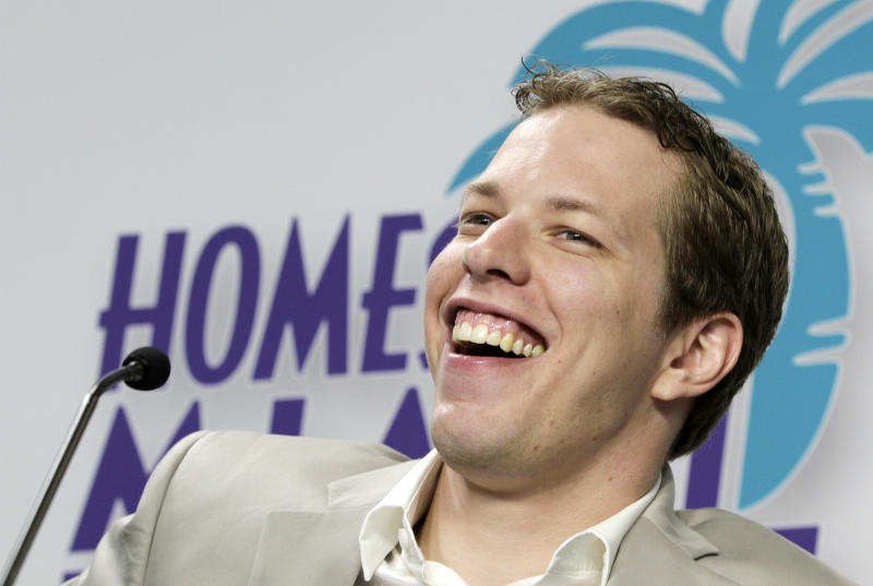 NASCAR driver Brad Keselowski laughs at a reporters question during a news conference for the Sprint Cup Series auto race in Homestead, Fla., Thursday, Nov. 15, 2012. (AP Photo/Alan Diaz)