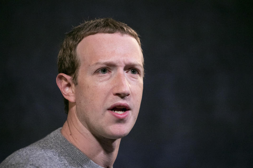 FILE - In this Oct. 25, 2019, file photo, Facebook CEO Mark Zuckerberg speaks at the Paley Center in New York. FILE - In this April 23, 2021, file photo, the Facebook app is shown in the app store on a smart phone in Surfside, Fla. Facebook on Wednesday, July 14 2021, is asking that the new head of the Federal Trade Commission step away from antitrust investigations into the social network giant, asserting that her past public criticism of the company's market power makes it impossible for her to be impartial. ( (AP Photo/Mark Lennihan, FIle)