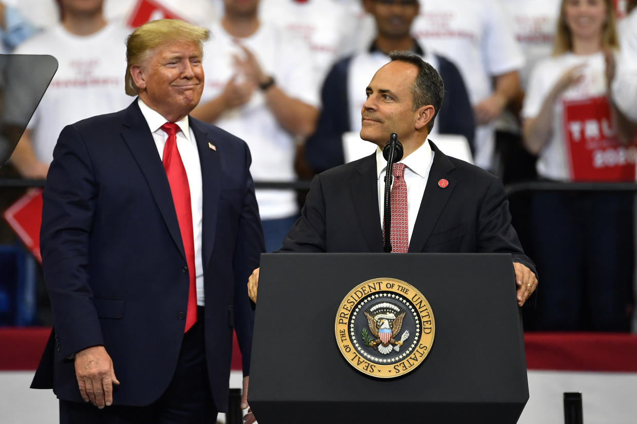 Kentucky Gov. Matt Bevin, right, looks out at the crowd as President Donald Trump watches during a campaign rally in Lexington, Ky., Nov. 4, 2019. (Photo: Timothy D. Easley/AP)