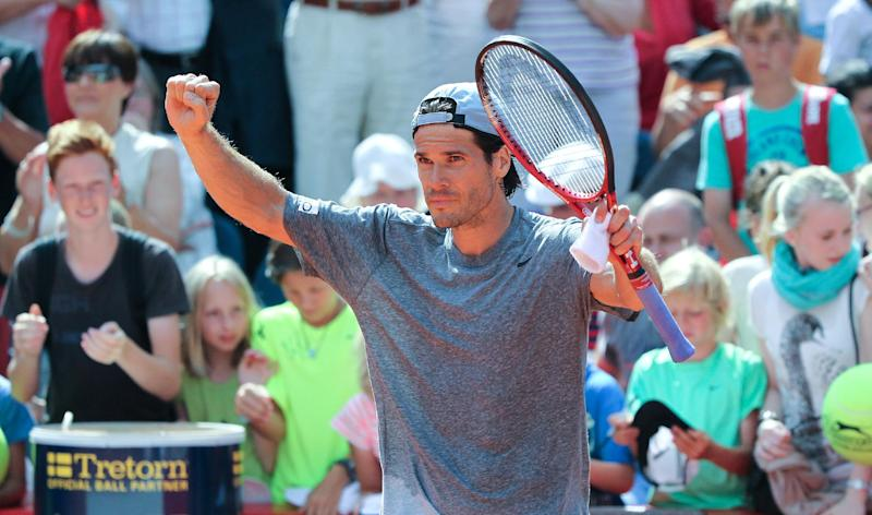 Germany's Tommy Haas celebrates after he won the round of sixteen match against Argentina's Carlos Berlocq during the International German Open ATP tennis tournament in Hamburg, Germany, Thursday July 18, 2013. (AP Photo/dpa, Axel Heimken)